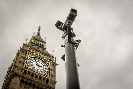 to dominate: CCTV cameras dominate a view of Big Ben historical London Landmark with no people present Stock Photo
