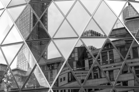 reflect: Triangle shaped abstract from window reflections of a modern office building Editorial
