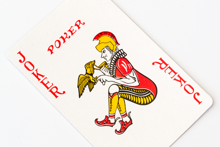 joker playing card: Single Macro shot of a red Joker playing card on a white background Stock Photo