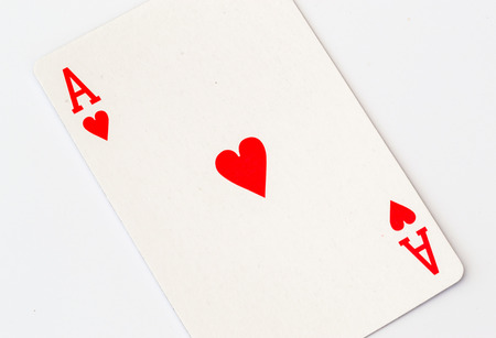 ace of hearts: Single red ace of hearts playing card shot in macro close up on a white background