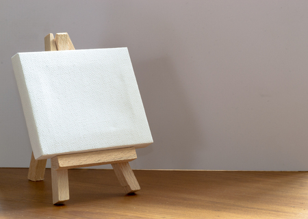 space   area: Close up of a wooden miniature model artists easel with copy space area and design space