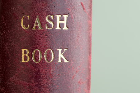 bank records: Classic Red leather textured office accounts cash book in gold embossed lettering