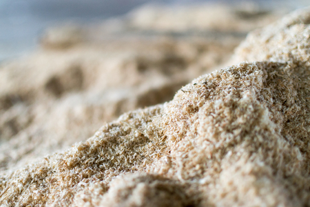 woodcutting: Pile of sawdust from an industrial woodcutting sawmill machine