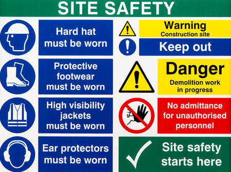 Brightly colored building site safety warning signs