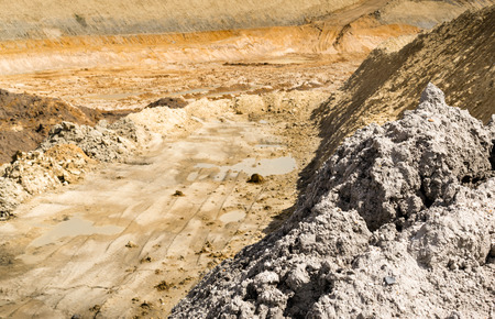 excavations: Background of a muddy quarry with different colored mud and excavations