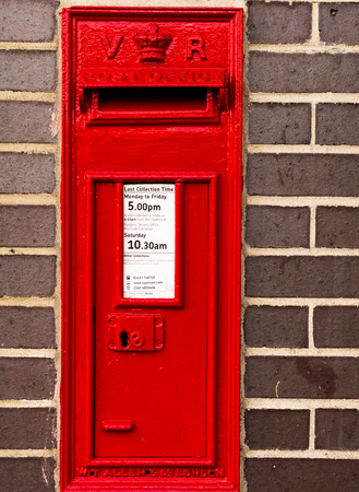 pillar box: 14 Aug - Red Postal box set in a brick wall offering a safe way for people to post their letters in August 2015 in Witham England