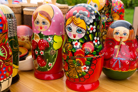 matrioska: Brightly painted traditional wooden Russian Matrushka puzzle dolls