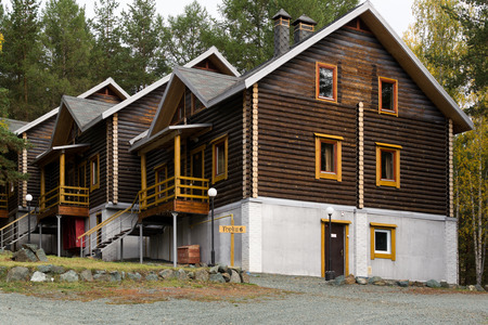 chalets: Traditional wooden ski chalets with no snow Stock Photo