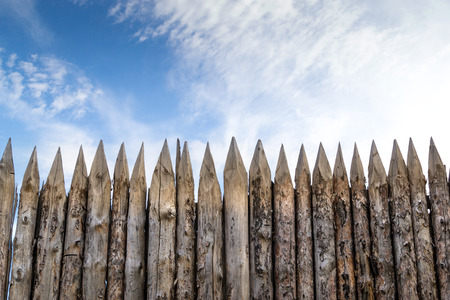 Wooden palisades form a defence barricade