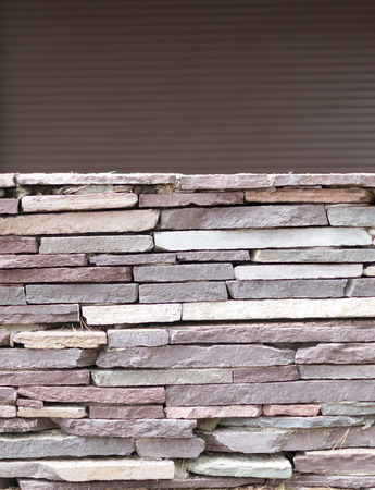 tiled wall: Loose tiled wall in grey stone with a copyspace backgroiund