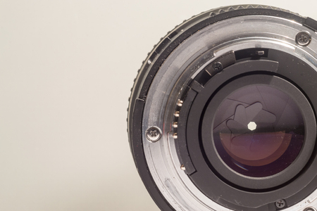rear end: Close-up image of the rear end of a camera lens showing diaphragms and aperture rings