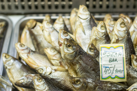 traditionally russian: 021115 - Dried salted fish on display in a local Russian Beer shop. The fish is a snack when drinking and is traditionally bought together with Beer.