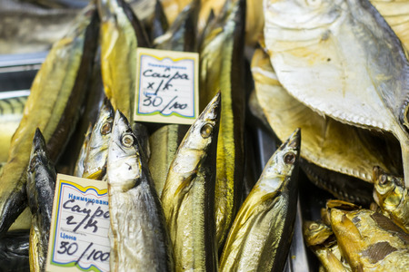 traditionally russian: 021115 - Dried salted Pacific saury (Cololabis saira) fish on display in a local Russian Beer shop. The fish is a snack when drinking and is traditionally bought together with Beer. Editorial