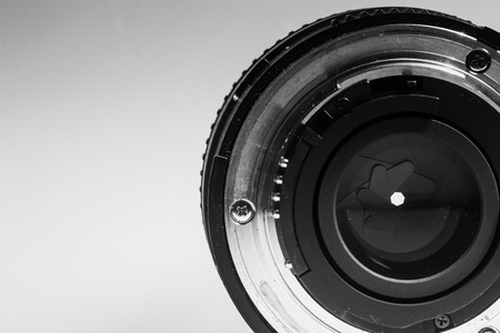 rear end: Close-up image of the rear end of a camera lens showing diaphragms and aperture rings in monochrome black and white