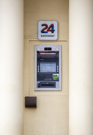 dispense: 021115 An ATM Cash machine in a Wall with columns  provides easy cash for shoppers in Ufa Russian 24 hours a day