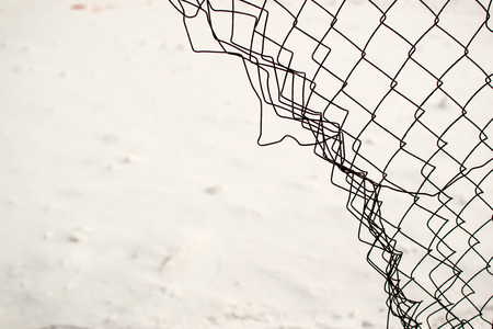 wire fence: Broken chain link fence with a snow white background