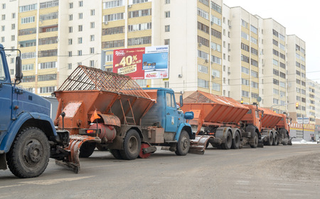 snow clearing: 20151128 - Russian snow clearing machines remove fresh ice and snow from the roads of a city in Ufa Russia in 2015 to increase road safety for people using the streets.
