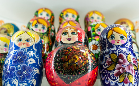 matriosca: Close-up image of many Russian Matryoshka nesting dolls. The famous Russian souvenir uses bright vibrant hand painted paints on their carved wooden surface.