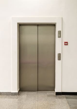 allowing: Everyday light entrance with closed metal doors allowing people to move from floor-to-floor