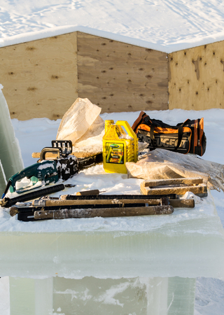 ice sculpture: UFA - RUSSIA 19TH DECEMBER 2015 - The tools of an ice sculpture worker rests on a block of frozen water in Ufa, Russia, 2015
