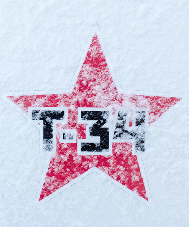t34: Russian T34 Tank in black font symbol sign using a red Soviet Style star, dusted in fresh snowfall for use in military or historical applications
