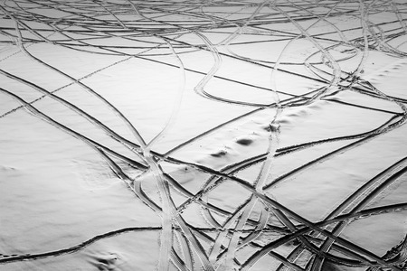 d mark: Fresh patterns in winter snow create abstract shapes and forms with natural sunlight creating areas of contrast amongst the peaks and troughs of the snowfall. Melting ice water adds to the wonderful winter landscapes. Stock Photo