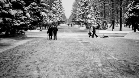 cleared: UFA - RUSSIA 16TH JANUARY 2016 - People walk and children play in the winter snow of Victory Park which is cleared of snow every day in Ufa, Russia in January 2016. Editorial