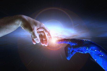 machine: AI hand reaches towards a human hand as a spark of understanding technology reaches across to humanity. Artificial Intelligence concept with copy space area. Blue flesh image.