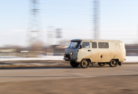 REIFKA - RUSSIA 11TH MARCH 2016 - Speeding Russian delivery UAZ vehilce on its way to offload its goods in Reifka, Russia on the 11th of March 2016