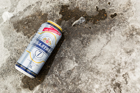 the thrown: UFA - RUSSIA 7TH MARCH 2016 - Single can of Baltika 7 beer resting on winter slush and snow, after been thrown away in Ufa, Russia 7th of March 2016.