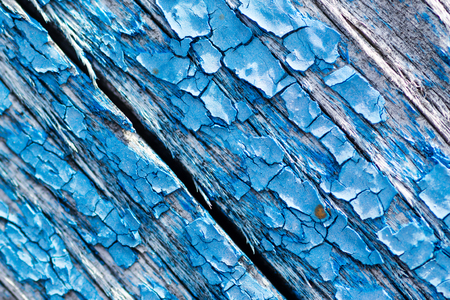 flaking: Flaking blue paint texture on aged decrepit wooden background Stock Photo