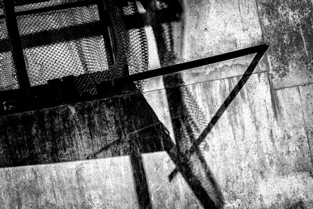 metal monochrome: Rusty metal and broken wire fencing black and white monochrome abstract