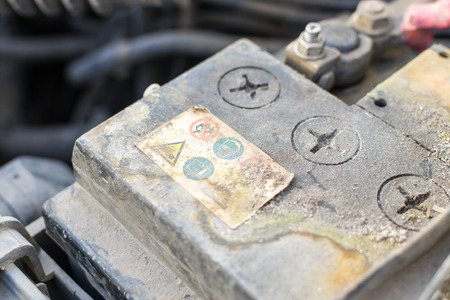 build up: Closeup image of a corroded and defective car battery showing erosion of the terminals and residue build up