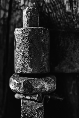 hinge: Rusty old industrial sized door hinge in black and white