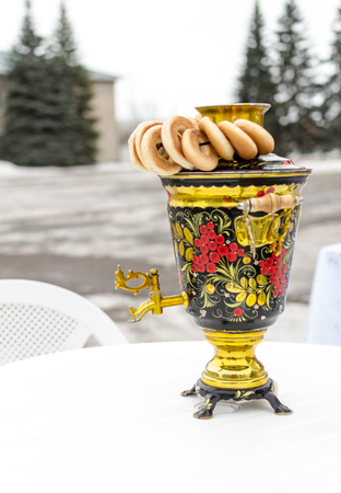 vibrant colours: Traditional Russian Samovar in vibrant colours and round bread rolls