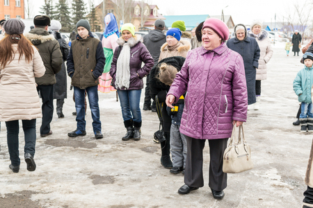 spectating: REIFKA - RUSSIA 6TH MARCH 2016 - Members of Public in Reifka in Russia celebrate the Maslenitsa festival marking the end of winter in March 2016.