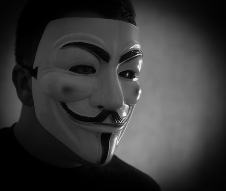 guy fawkes mask: UFA - RUSSIA 8TH MARCH 2016 - Man wears a Guy Fawkes Mask popular with anonymity to disguise his identity in Ufa, Russia, on the 8th of March 2016 Editorial