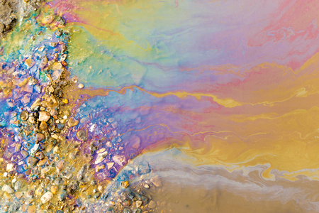 pollutants: Abstract of bright vibrant oil spill shapes of pollution on the surface of water. Patterns of multi-coloured pollutants releasing hazardous chemicals into the environment.
