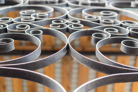 workmanship: Black painted wrought cast iron details show ornate patterns of workmanship.