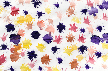 splats: Multi-coloured splats from a child painting showing splatter effects from a paintbrush. Horizontal composition with nobody.