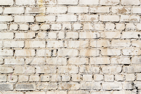 grimy: Grimy and dirt stained painted brick wall with marks and deterioration signs of age and wear. Stock Photo