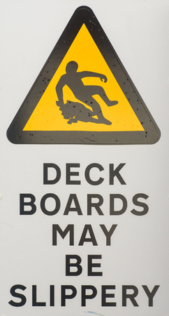 be wet: Health and safety hazard warning sign stating Deck Boards May Be Slippery When Wet for shipping or boat designs.