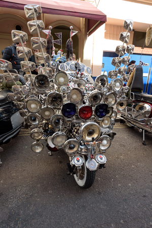 LONDON - ENGLAND 1ST MAY 2016 - A parked Lambretta Scooter covered in mirrors and lights in Soho, London during the May the 1st Bank Holiday London to Brighton Mod Rally