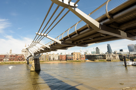 millennium bridge: Millennium Bridge in London that spans the River Thames from St Paul�s Cathedral to the Tate Modern Art Gallery. Nobody in the scene.