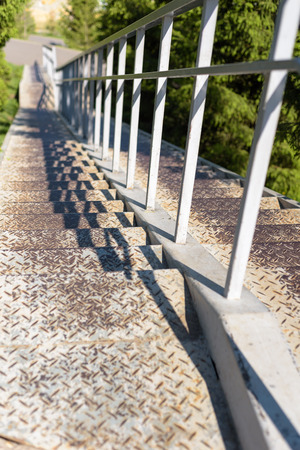 metal handrail: Grey painted metal steps with a strong sturdy hand rail leading downwards Stock Photo