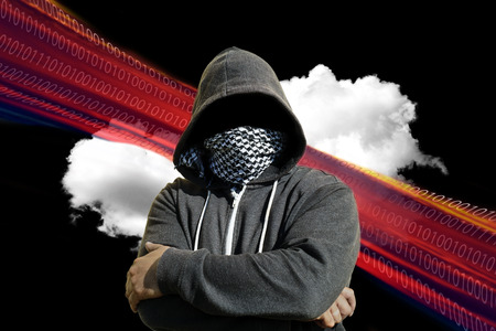 mainframe computer: Hooded and masked computer hacker thief with a cloud computer based background. Unknown technology threat to the cloud mainframe idea. Copy space area.