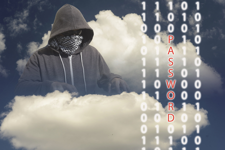 mainframe computer: Hooded and masked computer hacker thief with a cloud computer based binary code background. Unknown technology threat to the cloud mainframe idea. Copy space area.