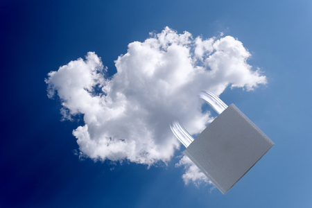 cloud based: White cloud and a closed metal padlock for technology and computing based security concepts and ideas. Copy space area for internet text