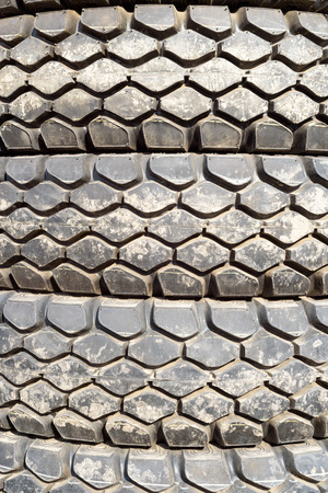 tyre tread: Stacked vehicle tyres lying on top of each other. Forming an abstract repeating pattern with tire treads.