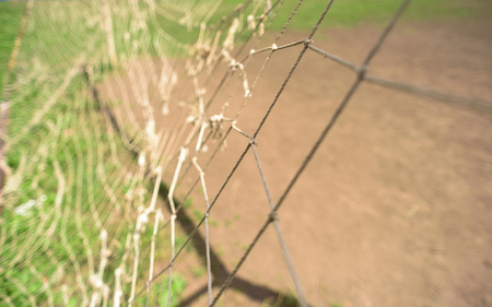 netting: Broken string netting of a football goal. Copy space area for sports based concepts and designs.